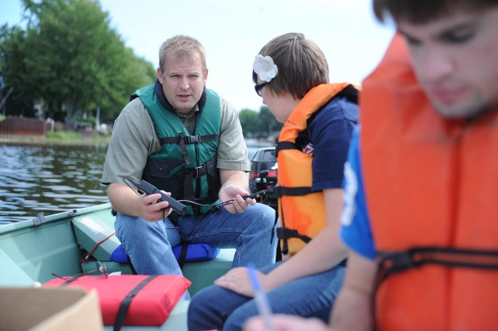 Director of SVSU's Saginaw Bay Environmental Science Institute David Karpovich on the river with student researchers (via SVSU Communications)