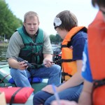Director of SVSU's Saginaw Bay Environmental Science Institute David Karpovich on the river with student researchers (via SVSU Communications)
